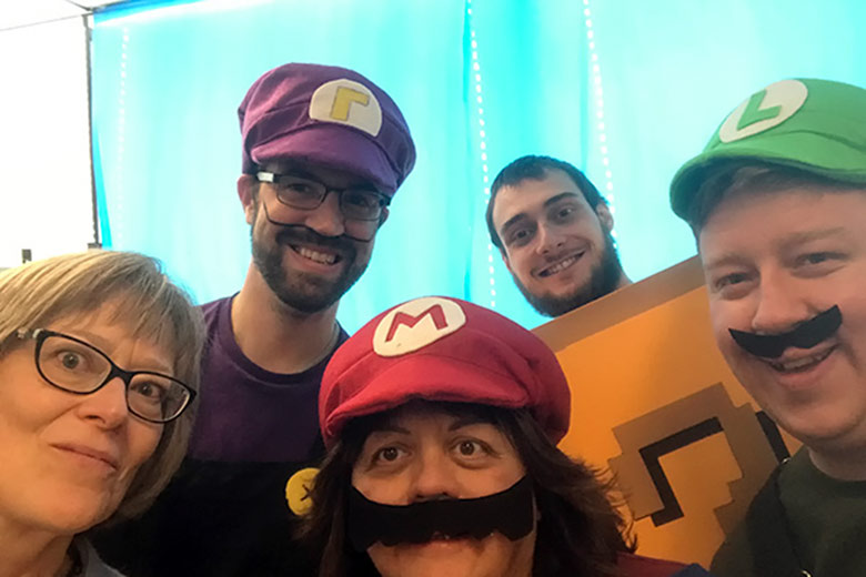 CEO Cathy Ulrich in a selfie with four staff members dressed as characters from Mario Kart.