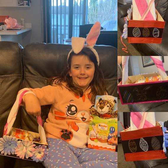 A young girl shows off her homemade Easter basket.