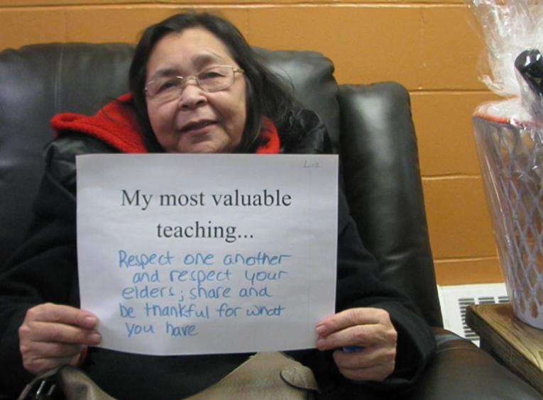 Person holding sign with their most valuable teaching.