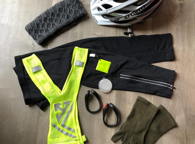 Fall biking gear, like pants, a high-visibility vest, helmet, and gloves.