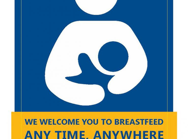 "The Breastfeeding-Friendly Spaces decal is pictured. It features a blue and white graphic of a mother and child breastfeeding and includes the text: ""We welcome you to breastfeed any time, anywhere."""