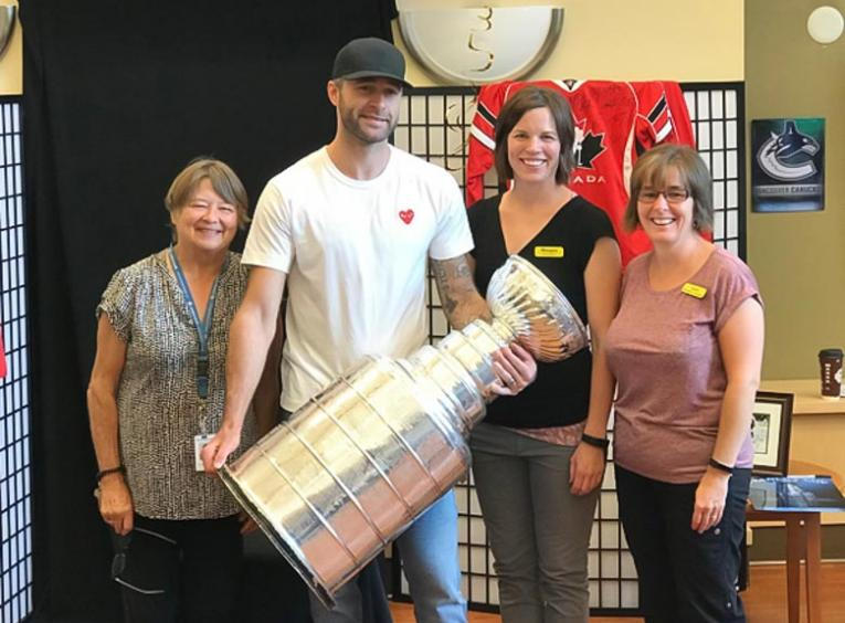 Brett Connolly poses with Gateway Lodge staff.
