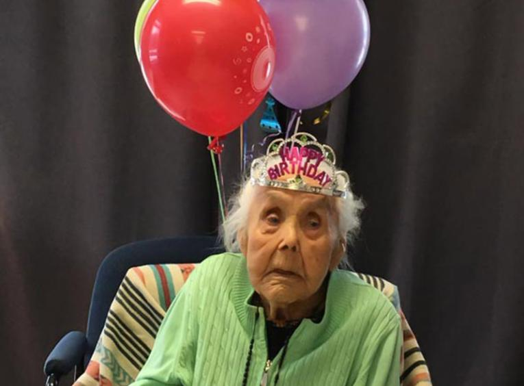 Catherine William celebrating her 103rd birthday with balloons.