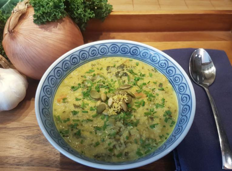 Bowl of Curried Cauliflower Kale Soup
