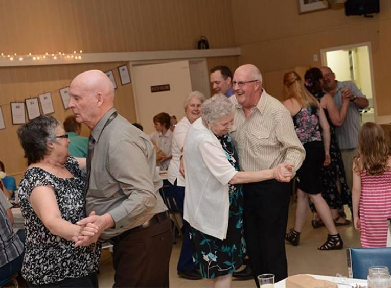A group of senior's dancing.