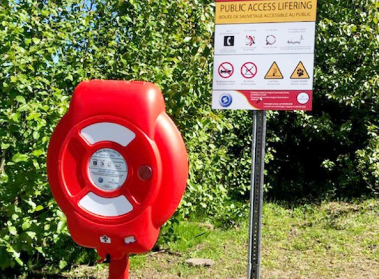 The installed Public Access Lifering is beside a sign that explains how to use it.