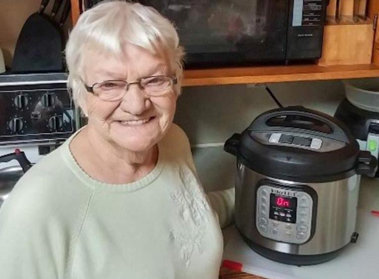 Adele's mom standing with her Instant Pot.