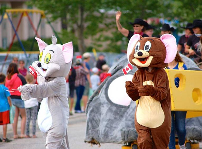 Parade with brown mouse and grey cat mascot