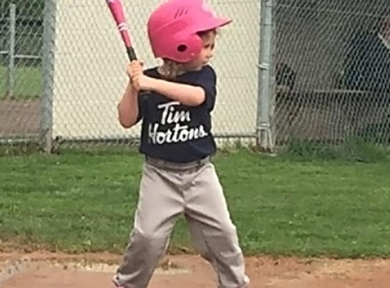 little boy up for bat baseball