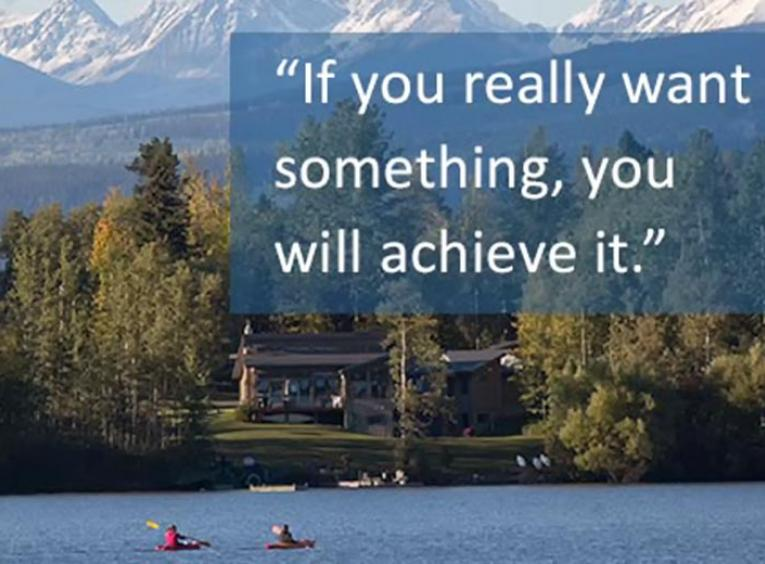 "People kayaking on lake with resort and mountains behind with ""If you really want something, you will achieve it"" quote on the graphic"