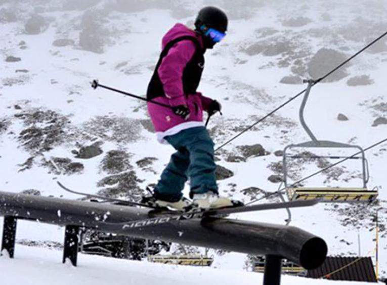 Skier sliding on a rail.
