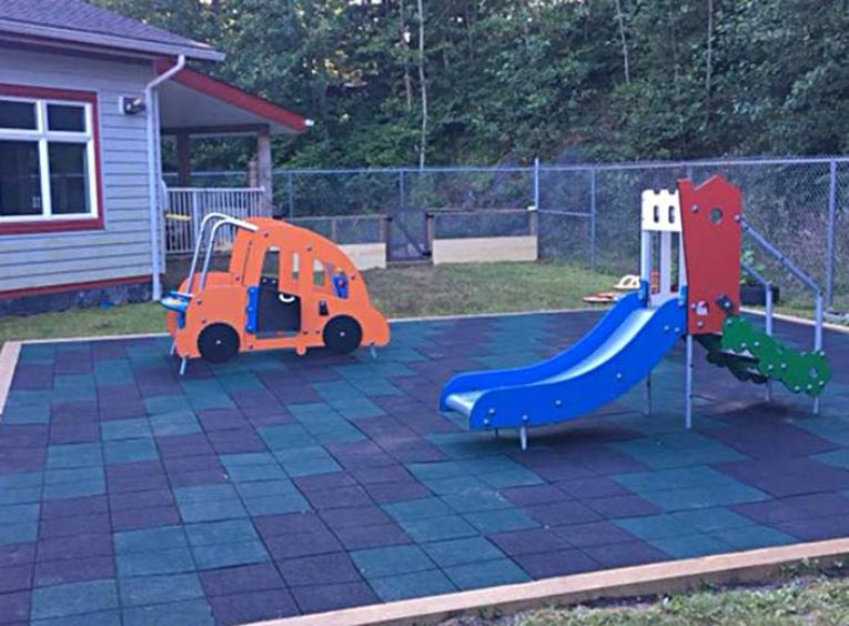 The outdoor play equipment and safety surface at the Discovery Childcare Centre.