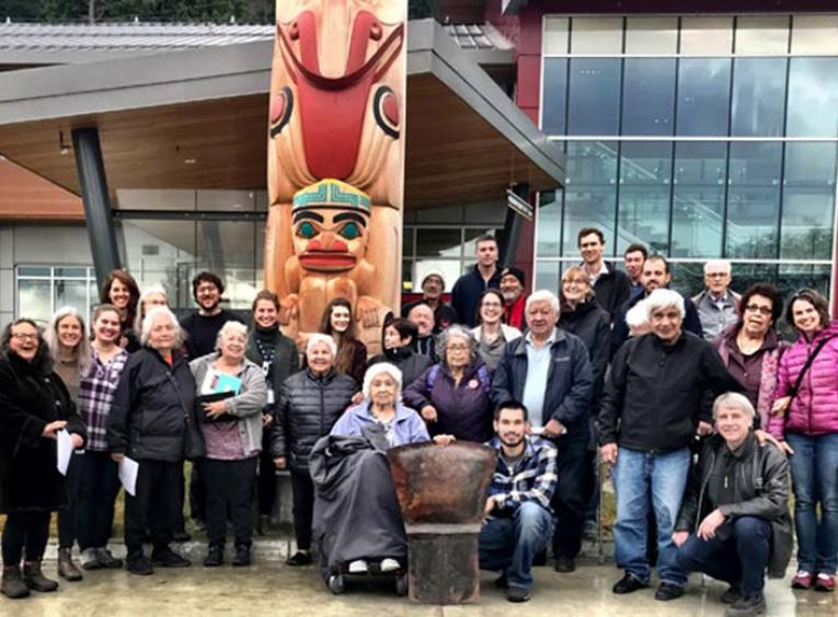 A group of people standing outside the Haida Gwaii Hospital and Health Centre.