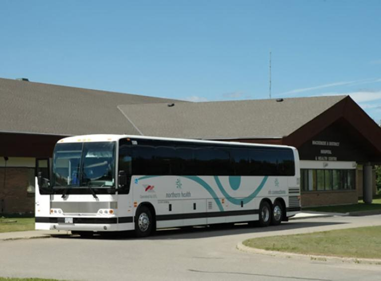 An NH Connections bus parked out front of the Mackenzie & District Hospital & Health Centre.