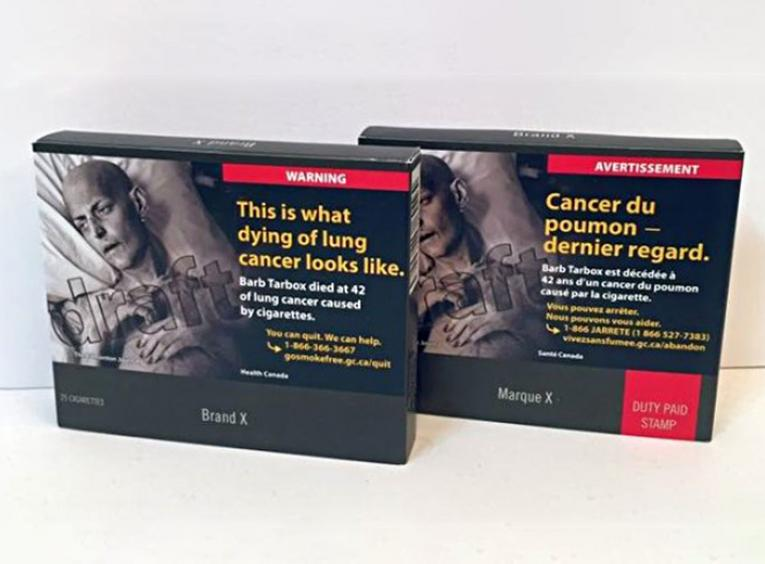 Two cigarette boxes in the new plain packaging.