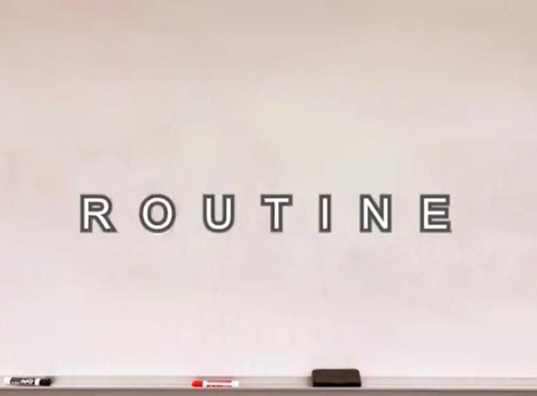 A whiteboard with the word Routine on it.