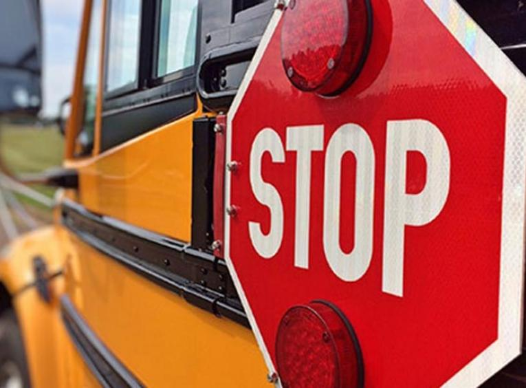 Stop sign on a school bus.