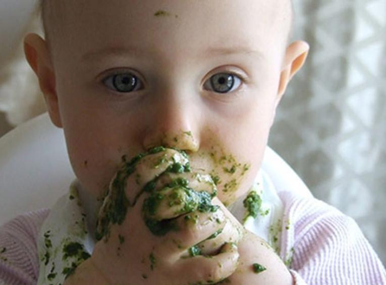 Baby eating solids.