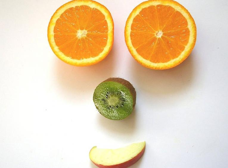 Fruit being used to make a face.