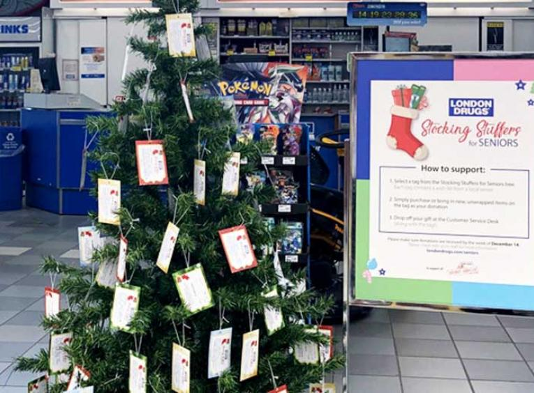 Christmas tree in the Prince George London Drugs store is decorated with tags containing seniors' gift wishes.
