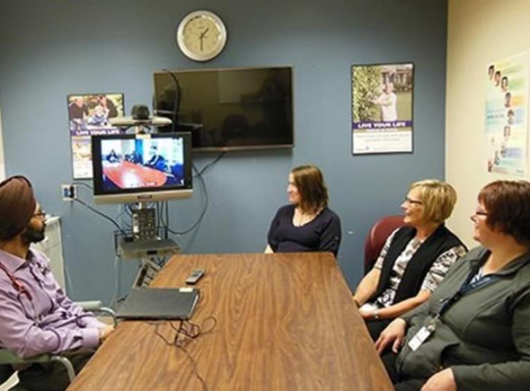 Healthcare professionals in a telehealth meeting.