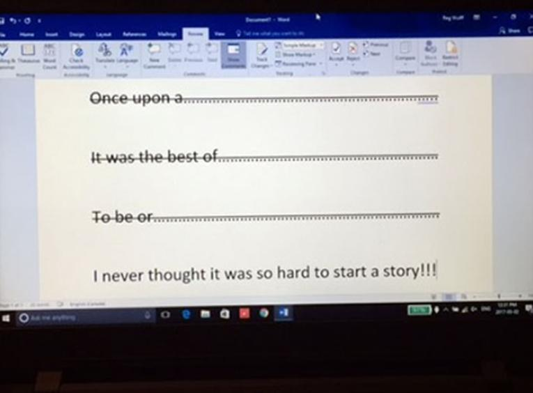 Laptop screen with opening story sentences crossed out.