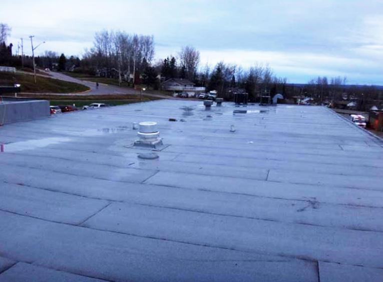 A flat roof is shown.