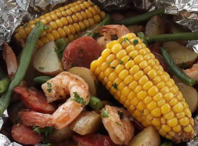 Shrimp, corn, potatoes in tin foil.