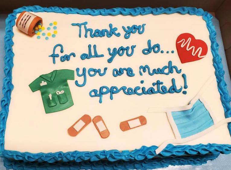 A cake with a message thanking health care providers for their work during COVID-19.