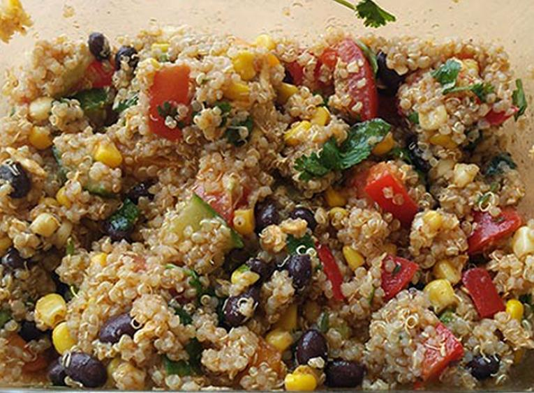Quinoa salad with vegetables in a glass pan