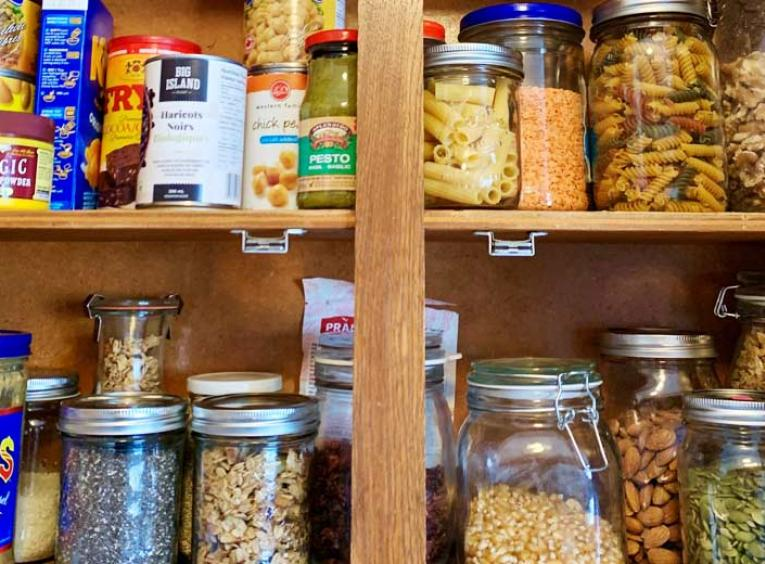 A stocked pantry, full of canned and tried items.
