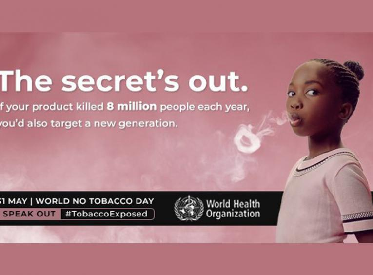 A WHO image for World No Tobacco Day shows a young girl blowing a smoke ring.