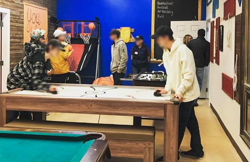 Youths playing air hockey