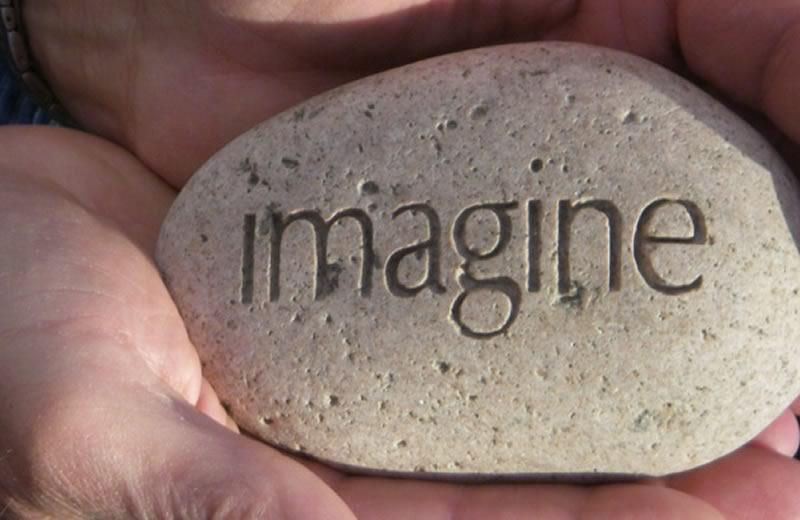 Rock with the word IMAGINE on it.
