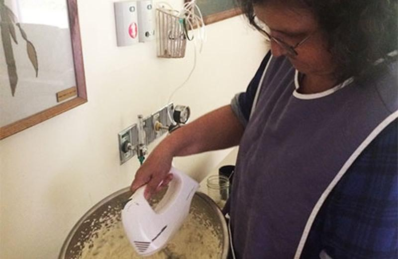 soWoman preparing soapberry ice cream.