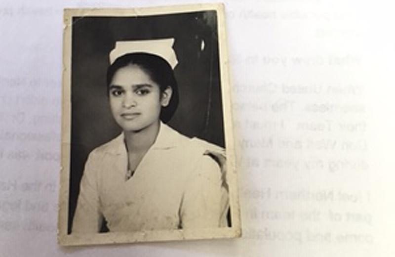 A young woman in her nursing outfit.