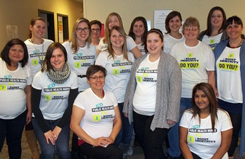 Group photo of Northern Health nurses wearing Immunization Awareness Week t-shirts