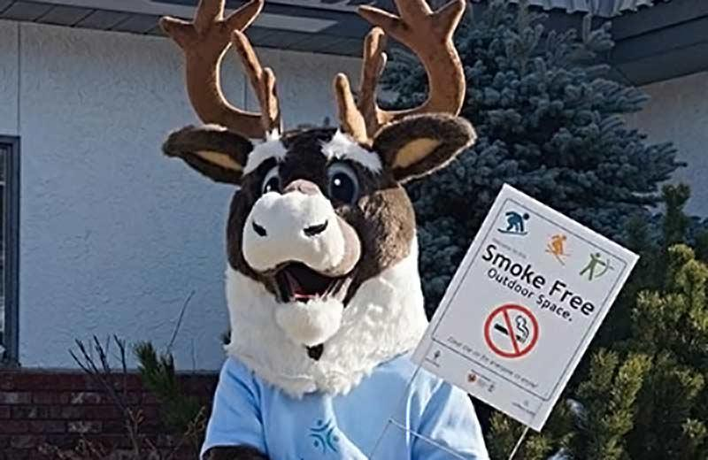 Mascot with smoke-free spaces sign