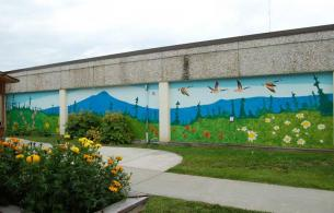 Beautiful mural on outdoor wall of long term care garden
